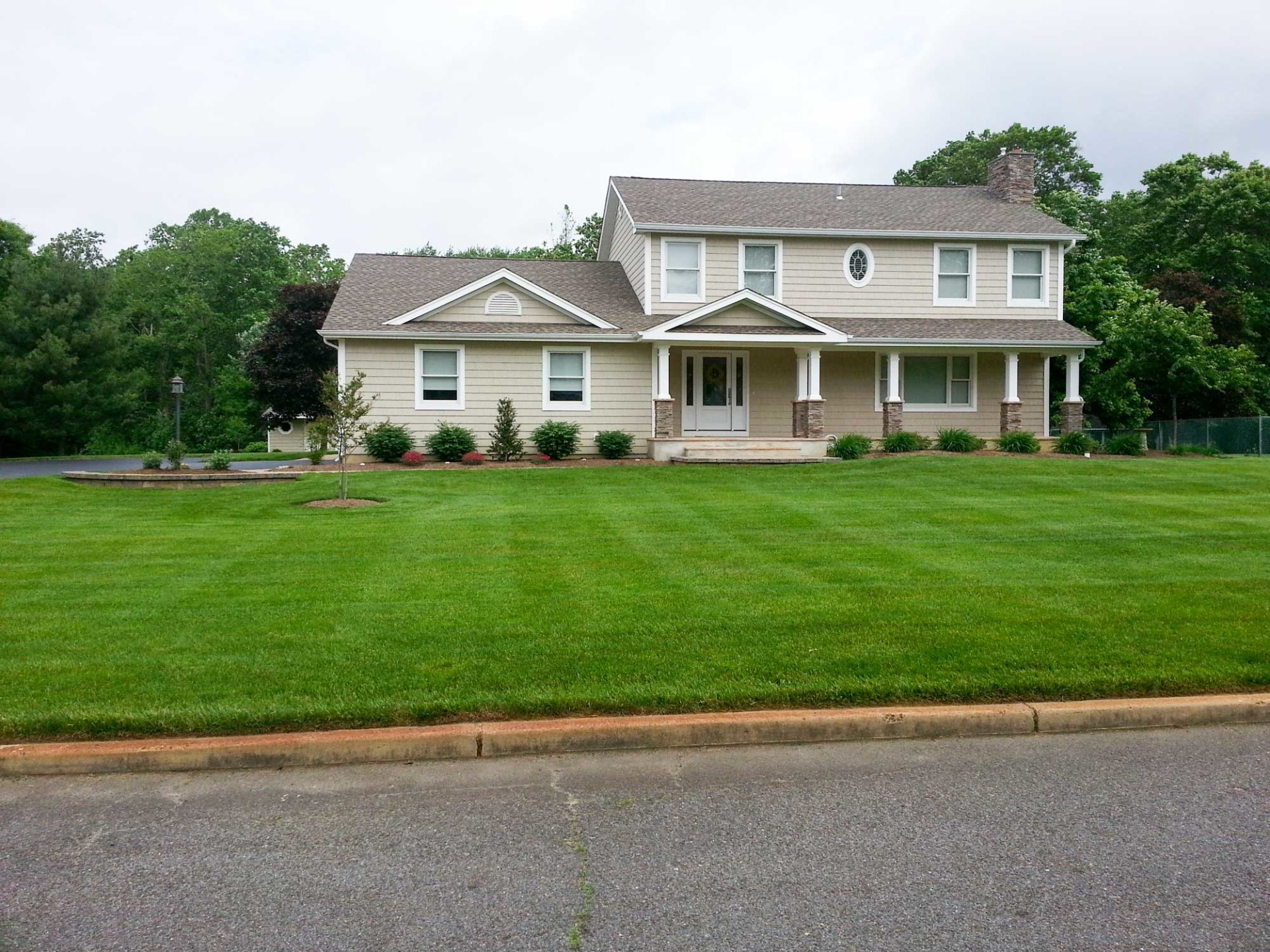 Plush Lawn In Front Yard Walkway And Newly Planted Beds