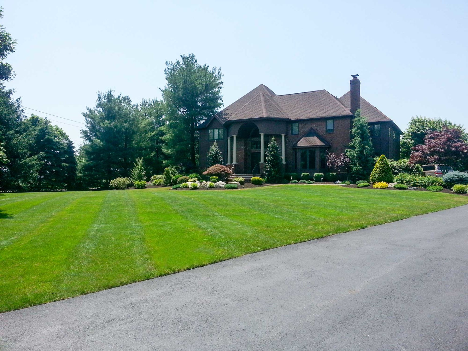 Rich Greens And Layered Landscaping Country Lawn Care Inc